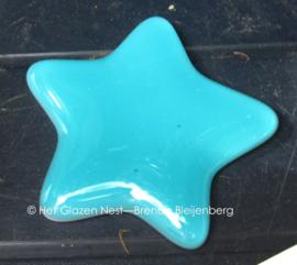 klein sterretje in licht zee blauw glas