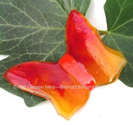 Klein oranje vlindertje van glas