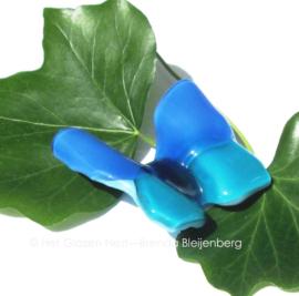 kleine vlinder in zeeblauwe kleuren