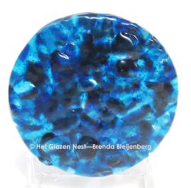 Kleine cirkel in grillig zee blauw glas