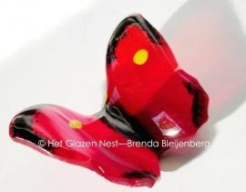 rood vlindertje met zwarte randjes