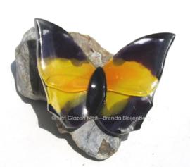 vlinder in geel en grijs