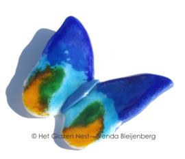 Blauwe vlinder met oranje accenten