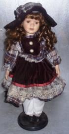 modepop met krullen en staander