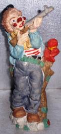 clown met geweer