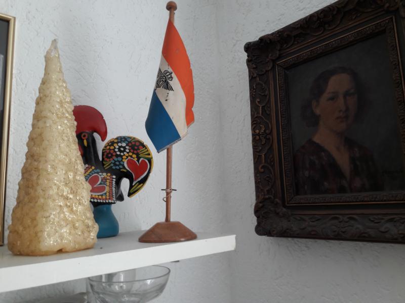 Antiek vlaggetje van de ORANJE (schip stoomvaart mij Nederland).