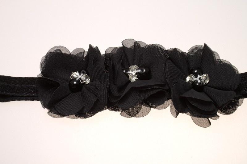 Babyhaarbandje zwart 3 bloemen, pareltjes en strass