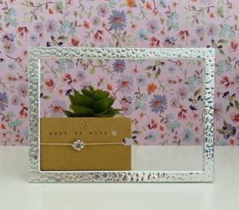 Armbandje elastiek met zilverkleurige bloem