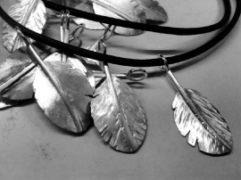 Zilveren veertjes hangers