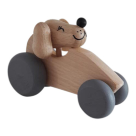 wooden dog in car - natural