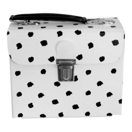 white handbag with black dots