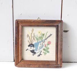 vintage borduurwerk vogel blauw