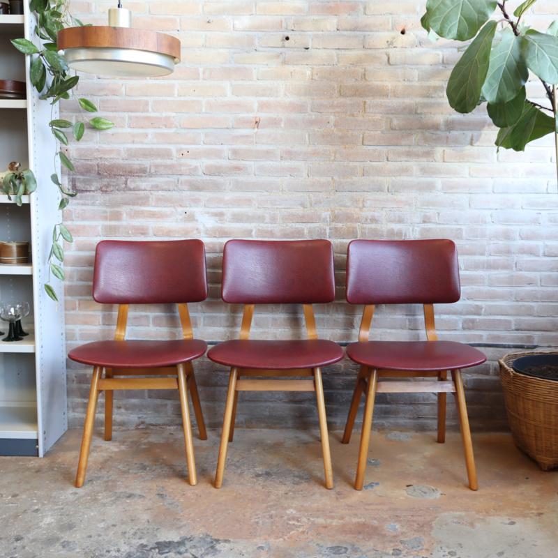 set. vintage stoelen rood skai