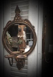 Oude spiegel met waxine