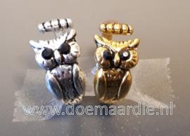 Ring, uil verstelbaar. Goud of zilverkleurig.