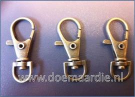 Sleutelhanger, sluiting, brons. 36 mm.