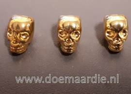 Skull, doodshoofd vertikaal gat, goud kleur.