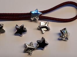 Kleine ster, zilverkleur, per 15.