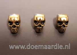Skull, doodshoofd vertikaal gat, oud goudkleur.