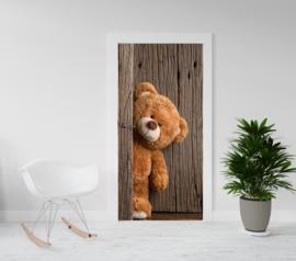 Deurposter - deursticker  Teddybeer die om het hoekje kijkt