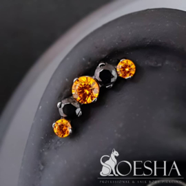 Industrial Strength's Prium Cluster with orange and black faceted cubic zirconia from Swarovksi