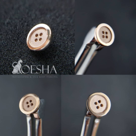Solid rose gold button