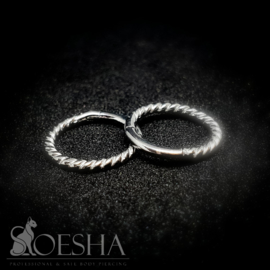 Fine twisted hinged segment click ring