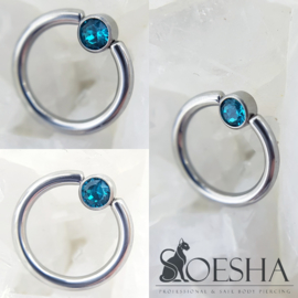Ball Closure Ring With Captive Gem