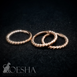 Fine twisted hinged segment click ring rose gold
