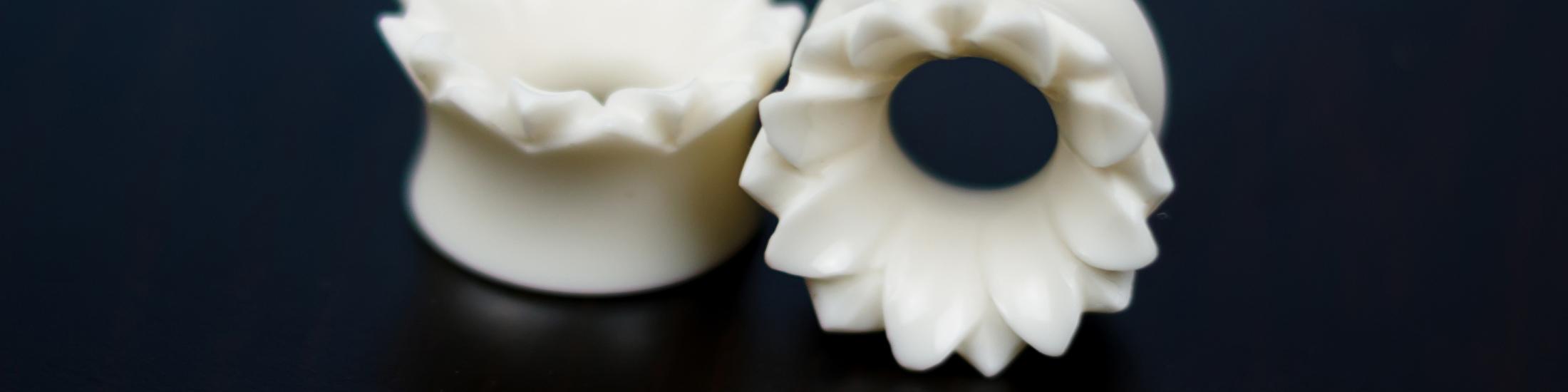 Bone flower double flare tunnels