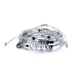Armband parels + schelp zilver