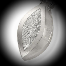 Oval pendant for ashes with fingerprint