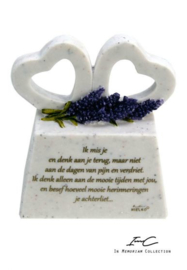 Memorial hearts on pedestal with poem