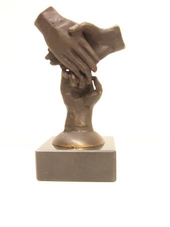 bronzen beeldje - sculptuur - abstract - de krachten bundelen