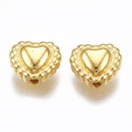 C458- ca. 40 stuks hartjes goudkleur 6.5x7.5x4