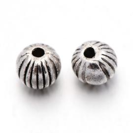 C324- ca. 100 stuks metalen kralen spacers 4mm zilverkleur