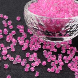 R23- 20gram glazen rocailles 4mm transparant met roze kern