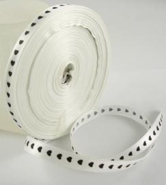 rol met 45 meter satijnlint van 10mm breed wit met zwarte hartjes - super aanbieding!