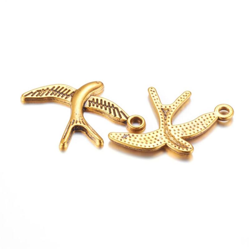 D88- 6 stuks bedels vogels 31x22mm goudkleur