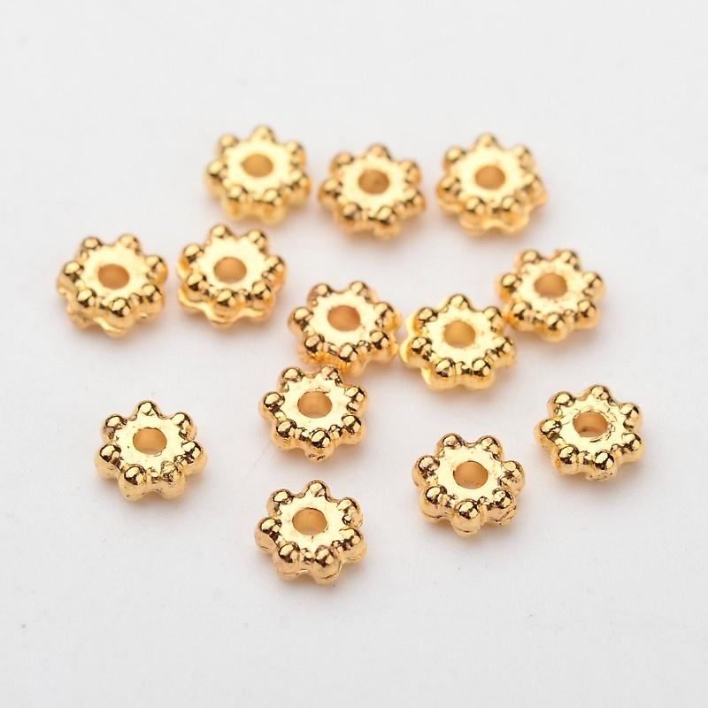 C73- ca. 400 stuks metallook mini spacers 4x1.7mm goudkleur