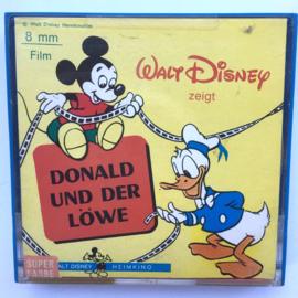 Nr.7183 Super 8  -- Donals en de leeuw Walt Disney iets rood van kleur, ongeveer 50 meter op spoel en in orginele doos