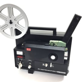 Nr.8200 --  TOP kwaliteit de Elmo, Sound ST-600 M 2-Track Black voor Super 8 mm film, sterke halogeenlamp: 100 W, 12 V,  spoel capaciteit: 180 m, heeft service beurt gehad en is in zeer goede staat.