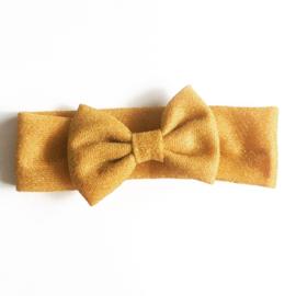 Glitter haarband met strik - okergeel