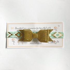 Haarband met chique motiefje - glitter strik goud