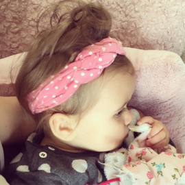 Baby haarband gevlochten - roze met witte stippen