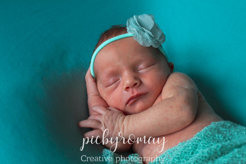 Baby haarbandje mintgroen - organza bloem