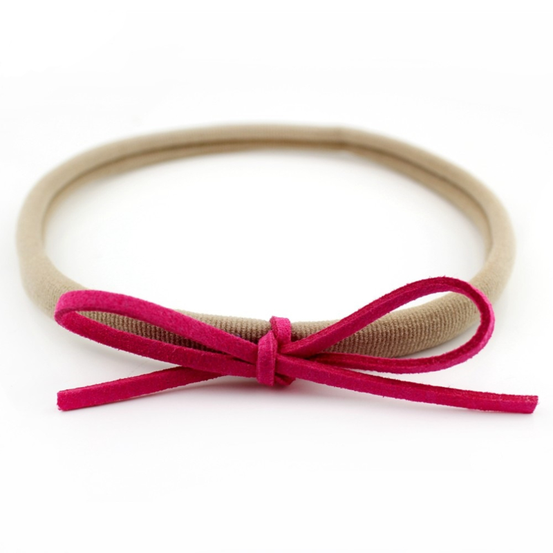 Nylon baby haarbandje met strikje - Fuchsia
