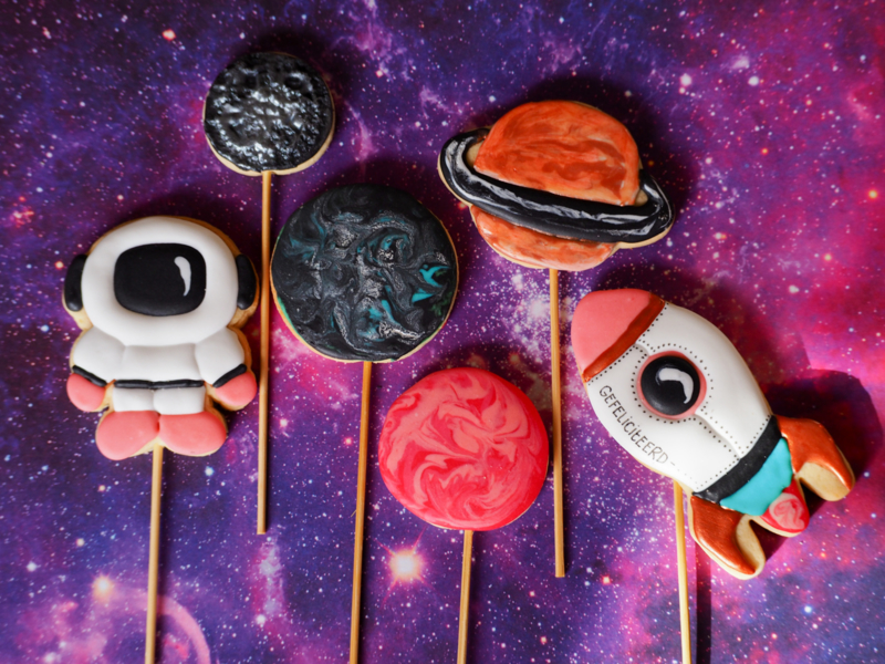 Space cookie cake topper