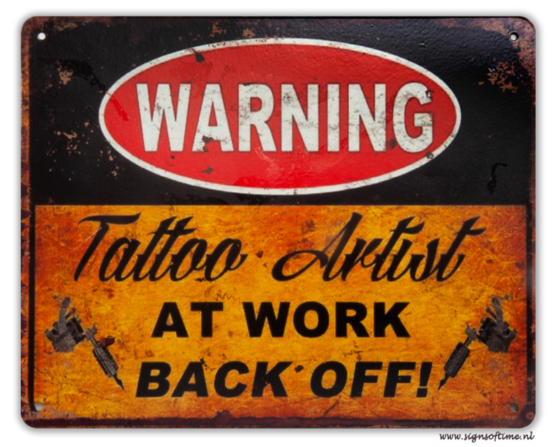 Warning Tattoo Artist at work