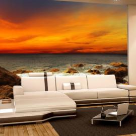 Fotobehang poster 0060 natuur strand zonsondergang oranje lucht rotsen